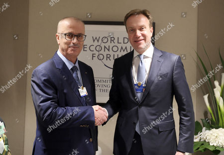 Palestinian Prime Minister Rami Hamdallah meets with World Economic Forum (WEF) President Borge Brende, during the annual meeting of the World Economic Forum in Davos, Switzerland