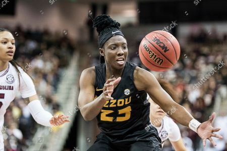 Missouri guard Amber Smith (23) reaches for a loose ball during an NCAA college basketball game, in Columbia, S.C. South Carolina defeated Missouri 79-65