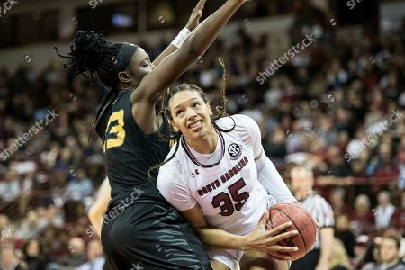 South Carolina forward Alexis Jennings (35) drives to the hoop against Missouri Tigers guard Amber Smith (23) during an NCAA college basketball game, in Columbia, S.C. South Carolina defeated Missouri 79-65