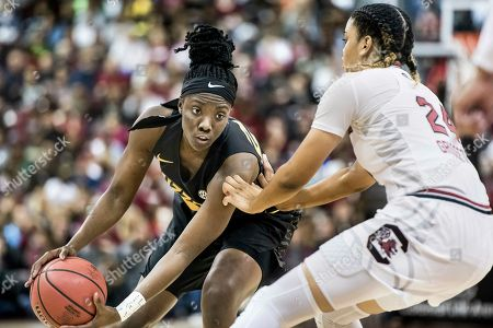 Amber Smith, Lele Grissett. Missouri guard Amber Smith (23) makes a move against South Carolina forward LeLe Grissett (24) during an NCAA college basketball game, in Columbia, S.C. South Carolina defeated Missouri 79-65