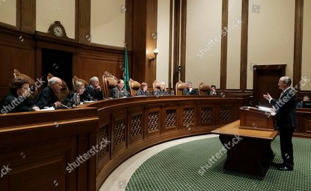 Stock Photo of Lawrence Lessig, right, an attorney representing three Washington state presidential electors, speaks, during a Washington Supreme Court hearing in Olympia, Wash., on a lawsuit addressing the constitutional freedom of electors to vote for any candidate for president, not just the nominee of their party