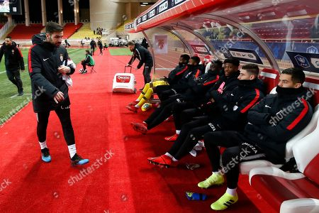 Cesc Fabregas (L) of AS Monaco takes his seat on the substitute bench prior to the French Cup round of 16 soccer match between AS Monaco and FC Metz at Stade Louis II, in Monaco, 22 January 2019.