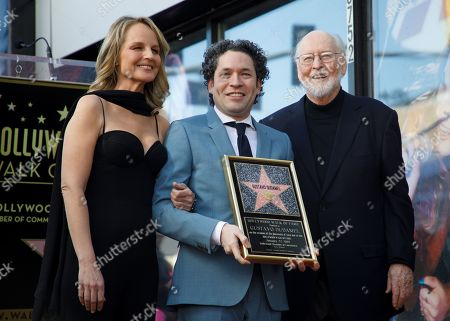 Venezuelan conductor Gustavo Dudamel (C) poses with US actress Helen Hunt (L) and composer John Williams during his Walk of Fame Star unveiling ceremony on Hollywood Boulevard in Hollywood, California, USA, 22 January 2019. Dudamel received the 2,654th star in the Live Performance category, he is currently the music director for the Los Angeles Philharmonic.