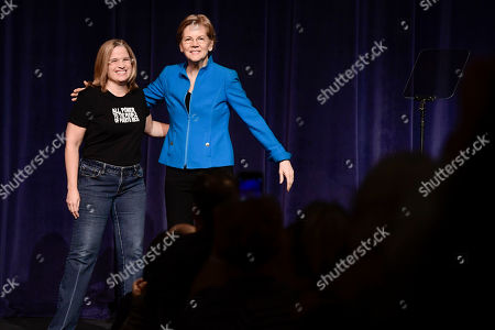 "Elizabeth Warren, United States senator from Massachusetts and one of the many Democrats running for president in 2020, enters the stage with San Juan Mayor Carmen Yulin Cruz Soto, moments before the beginning of the ""Community Conversation about Puerto Rico and its Recovery"" held at the Alejandro Tapia y Rivera Theater, in San Juan, Puerto Rico"