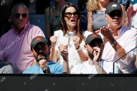 Belgian model Camille Ringoir (C) watches her boyfriend Milos Raonic of Canada in action during his men's singles quarter final match against Lucas Pouille of France at the Australian Open Grand Slam tennis tournament in Melbourne, Australia, 23 January 2019.
