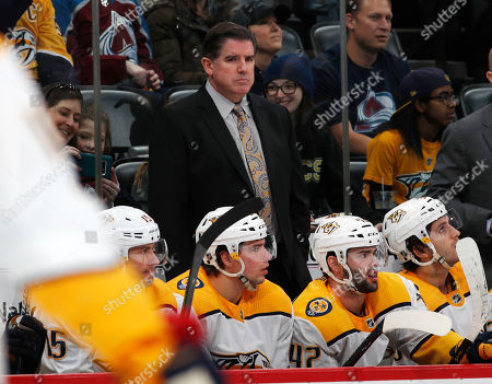 R m. Nashville Predators head coach Peter Laviolette in the first period of an NHL hockey game, in Denver