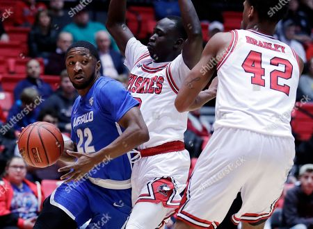 Dontay Caruthers, Gairges Daow, Levi Bradley. Buffalo guard Dontay Caruthers, left, looks to pass against Northern Illinois guard Gairges Daow, center, and Levi Bradley during the first half of an NCAA college basketball game, in DeKalb, Ill