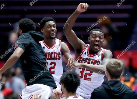 Stock Picture of Levi Bradley, Austin Richie. Northern Illinois' Levi Bradley (42) and Austin Richie (32) celebrate with teammates after Northern Illinois defeated Buffalo 77-75 in an NCAA college basketball game, in DeKalb, Ill