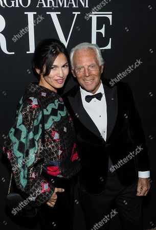 Stock Picture of Giorgio Armani (R) greets Elodie Yung