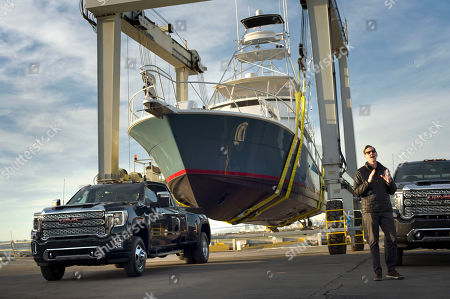 Stock Picture of Duncan Aldred, vice president of Global GMC, speaks next to a 2020 Sierra HD Denali 3500 and the small ship it pulled during a presentation of GMC's three new 2020 Sierra heavy duty pickup trucks in San Diego, California, USA, 22 January 2019.