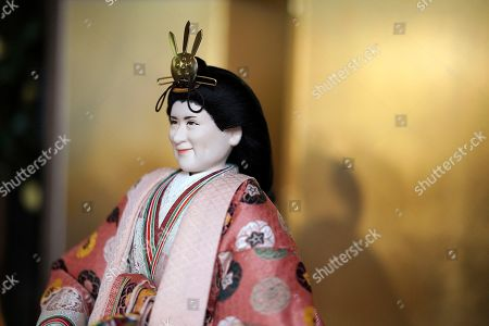 """A """"hina"""" doll depicting Japan's Crown Princess Masako ahead of her inauguration as empress in May, is displayed for Girls' Day celebrations at Kyugetsu Co., a Japanese traditional doll company, in Tokyo . The doll is among others adorned with images based on persons of the year. March 3 is celebrated as Girls' Day to pray for the vigorous growth of girls in the family"""