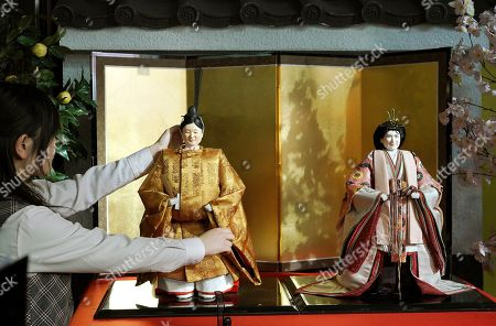 """Hina"""" dolls depicting Japan's Crown Prince Naruhito, left, and Crown Princess Masako ahead of their inauguration as emperor and empress in May, are displayed for Girls' Day celebrations at Kyugetsu Co., a Japanese traditional doll company, in Tokyo . The doll is among others adorned with images based on persons of the year. March 3 is celebrated as Girls' Day to pray for the vigorous growth of girls in the family"""