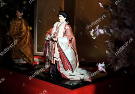 "A ""Hina"" dolls depicting Japanese Crown Prince Naruhito, left, and Crown Princess Masako ahead of their inauguration as emperor and empress in May, are displayed for Girls' Day celebrations at Kyugetsu, a Japanese traditional doll company, in Tokyo . The dolls are among others adorned with images based on persons of the year. March 3 is celebrated as Girls' Day to pray for the vigorous growth of girls in the family"