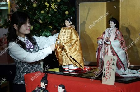 "Hina"" dolls depicting Japan's Crown Prince Naruhito and Crown Princess Masako, right, ahead of their inauguration as emperor and empress in May, are displayed for Girls' Day celebrations at Kyugetsu, a Japanese traditional doll company, in Tokyo . The dolls are among others adorned with images based on persons of the year. March 3 is celebrated as Girls' Day to pray for the vigorous growth of girls in the family"