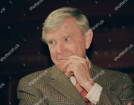 """Writer Russell Baker, ponders a reporter's question during a New York news conference where he was presented as the successor to host Alistair Cooke for the PBS series """"Masterpiece Theatre."""" Pulitzer Prize-winning author and humorist Baker has died at age 93. Allen Baker told The Associated Press that his father died on Monday, Jan. 21, 2019, from complications after a fall"""