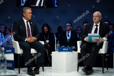 Ivan Duque, President of Colombia (L), next to Martin Wolf, Financial Times, attend the 49th annual meeting of the World Economic Forum (WEF) in Davos, Switzerland, 23 January 2019. The meeting brings together entrepreneurs, scientists, corporate and political leaders in Davos under the topic 'Globalization 4.0' from 22 to 25 January 2019.