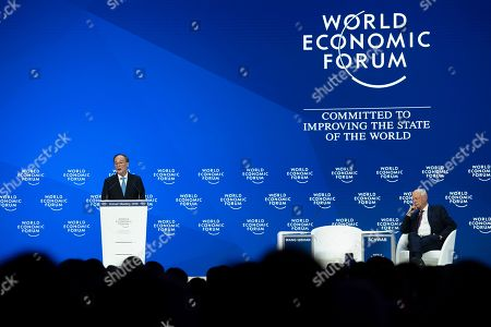 Wang Qishan, Vice-President of the People's Republic of China, (L), next to German Klaus Schwab, Founder and Executive Chairman of the World Economic Forum, WEF, during a plenary session in the Congress Hall at the 49th annual meeting of the World Economic Forum, WEF, in Davos, Switzerland, 23 January 2019. The meeting brings together entrepreneurs, scientists, corporate and political leaders in Davos under the topic 'Globalization 4.0' from 22 to 25 January 2019.