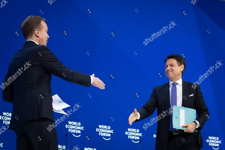 Giuseppe Conte (R), Prime Minister of Italy, and Borge Brende (L), President of the Managing Board of the WEF, greet each othrer during a plenary session in the Congress Hall during the 49th annual meeting of the World Economic Forum, WEF, in Davos, Switzerland, 23 January 2019. The meeting brings together entrepreneurs, scientists, corporate and political leaders in Davos under the topic 'Globalization 4.0' from 22 to 25 January 2019.
