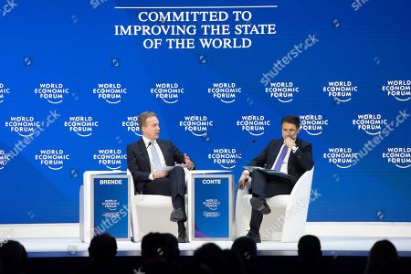 Giuseppe Conte (R), Prime Minister of Italy, and Borge Brende (L), the President of the Managing Board of WEF, attend a plenary session in the Congress Hall during the 49th Annual Meeting of the World Economic Forum, WEF, in Davos, Switzerland, 23 January 2019. The meeting brings together entrepreneurs, scientists, corporate and political leaders in Davos under the topic 'Globalization 4.0' from 22 to 25 January 2019.