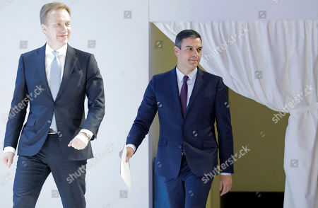 Spain Prime Minister Pedro Sanchez follows the President of the World Economic Forum Borge Brende, left, on to the stage to address the annual meeting of the World Economic Forum in Davos, Switzerland