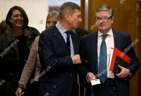 European Commissioner for Digital Single Market Andrus Ansip, center, speaks with EU Commissioner for Security Union Julian King prior to a weekly College of Commissioners meeting at EU headquarters in Brussels