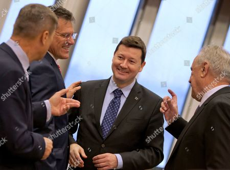 Secretary General of the European Commission Martin Selmayr, second right, speaks European Commissioner for Digital Single Market Andrus Ansip, left, and European Commissioner for Energy Union Maros Sefcovic, second left, during the weekly College of Commissioners meeting at EU headquarters in Brussels