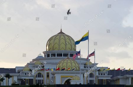 Stock Image of A bird flies near the Malaysian National Palace (Istana Negara) in Kuala Lumpur, Malaysia, 23 January 2019. Malaysia's Conference of Rulers will meet at the Palace on 24 January 2019 to decide which of the country's nine sultans will become its next head of state, known as Yang di-Pertuan Agong (Malaysian King), for the next five years. The new King is expected to be installed on 31 January. The move comes after the abdication of Sultan Muhammad V of Kelantan on 06 January 2019 as the country's 15th Agong, or Supreme Ruler, after just two years on the throne. The appointment of the king is rotated among nine of Malaysia's 13 states that have hereditary royal rulers.
