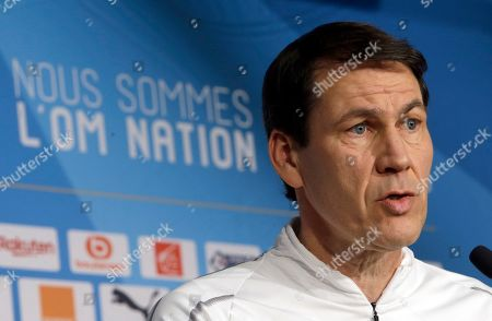 Olympique Marseille coach Rudi Garcia answers reporters during a press conference, at the club's headquarters of La Commanderie, in Marseille, southern France