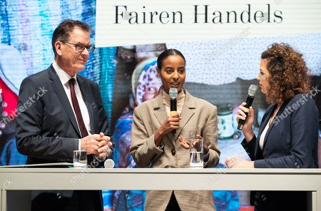 Germany's Minister for Economic Cooperation and Development Gerd Mueller (L) and the Ambassador of Fair Trade of the German Federal Ministry of Economic Cooperation and Development (German: Bundesministerium für wirtschaftliche Zusammenarbeit und Entwicklung, BMZ), model Sara Nuru (C) attend a discussion during the International Green Week fair in Berlin, Germany, 23 January 2019. Moderator (R) is not identified. The International Green Week fair runs from 18 to 27 January 2019. This year's partner country is Finland.