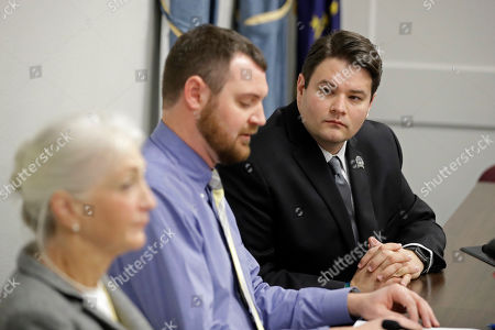 Sen. J.D. Ford, right, D-Indianapolis, listens as Matt White and Liz White during a news conference before a committee hearing at the Statehouse, Indianapolis