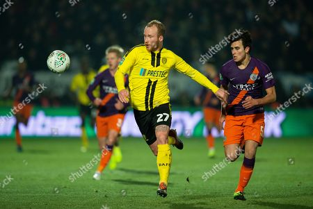 Stock Picture of Burton Albion's Liam Boyce (L) in action with Manchester City's Eric García (R) during the Carabao Cup semi-final second leg soccer match between Burton Albion and Manchester City held at the Pirelli Stadium in Burton upon Trent, Britain, 23 January 2019.