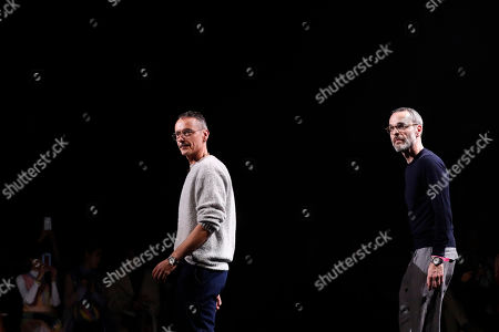Stock Picture of Viktor Horsting, Rolf Snoeren. Designers Viktor Horsting, left, and Rolf Snoeren accept applause at the end of their Spring/Summer 2019 Haute Couture fashion collection presented in Paris