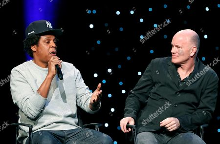 """Stock Photo of Shawn Jay Z Carter, Michael Novogratz. Rapper and business mogul Shawn """"Jay-Z"""" Carter, left, speaks as Michael Novogratz, founder and CEO Galaxy Digital, listens during the launch of a partnership among entertainment moguls, recording artists, business and sports leaders who hope to transform the American criminal justice system, in New York. The group, called the Reform Alliance, will be led by Van Jones, a CNN host, activist and former adviser to President Barack Obama"""