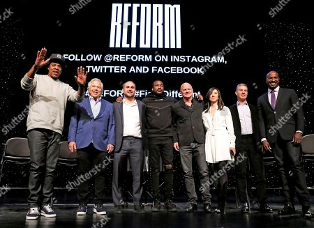 "Stock Image of Shawn Jay-Z Carter, Robert Kraft, Michael Rubin, Meek Mill, Michael Novogratz, Clara Wu Tsai, Daniel Loeb, Van Jones. Entrepreneur ad recording artist Shawn ""Jay-Z"" Carter, from left, gestures as he poses with New England Patriots owner Robert Kraft, Philadelphia 76ers co-owner and Fanatics executive chairman Michael Rubin, recording artist Meek Mill, Galaxy Digital CEO and founder Michael Novogratz, Brooklyn Nets co-owner Clara Wu Tsai, Third Point CEO and founder Daniel S. Loeb, and REFORM Alliance CEO and political activist Van Jones after the group announced a partnership to transform the American criminal justice system, in New York"
