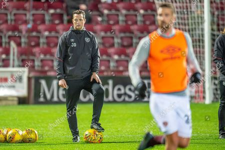 Hearts coach, Jon Daly, takes the warm up before the Ladbrokes Scottish Premiership match between Heart of Midlothian and Dundee at Tynecastle Stadium, Edinburgh