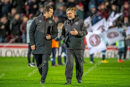 Craig Levein, manager of Heart of Midlothian speaks with coach Jon Daly (left) before the Ladbrokes Scottish Premiership match between Heart of Midlothian and Dundee at Tynecastle Stadium, Edinburgh