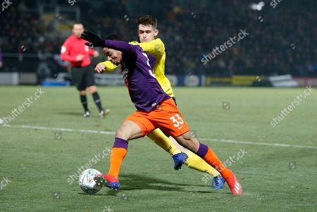Manchester City's Gabriel Jesus takes on Ben Fox of Burton Albion