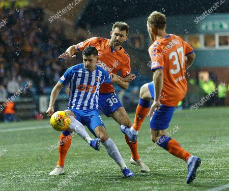 Jordan Jones of Kilmarnock tackled by Gareth McAuley & Scott Arfield of Rangers