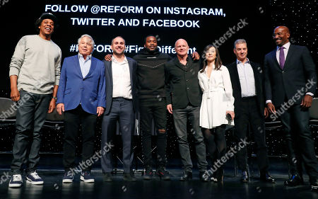"""From left, Business mogul, entrepreneur ad recording artist Shawn """"Jay-Z"""" Carter poses for a group photograph with New England Patriots owner Robert Kraft, Philadelphia 76ers co-owner and Fanatics executive chairman Michael Rubin, recording artist Meek Mill, Galaxy Digital CEO and founder Michael Novogratz, Brooklyn Nets co-owner Clara Wu Tsai, Third Point CEO and founder Daniel S. Loeb, and REFORM Alliance CEO and political activist Van Jones after the group announced the launch of a partnership to transform the American criminal justice system, in New York"""
