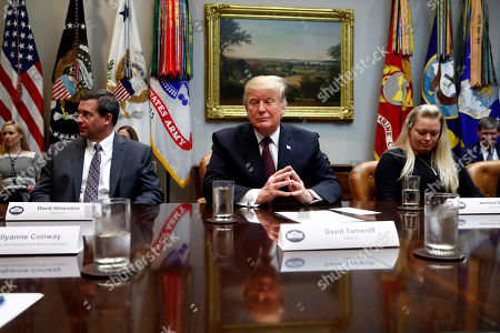 Donald Trump, David Silverstein, Jamesia Shutt. President Donald Trump listens during a healthcare roundtable in the Roosevelt Room of the White House, in Washington. With the president are David Silverstein, of Denver, left, and Jamesia Shutt, of Aurora, Colo., right