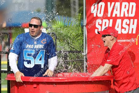 NFC coach Brian Urlacher is seen being splashed by AFC coach Jim Kelly after the 40 Yard Splash event at the Pro Bowl Skills Challenge, in Kissimmee, FL