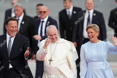 Panamanian President Juan Carlos Varela (L) and First Lady Lorena Castillo Garcia de Varela (R) welcome Pope Francis (C) upon his arrival at the International Tocumen Airport, in Panama City, Panama, 23 January 2019. Panama will host the World Youth Day (WYD) from 23 until 27 January 2019, one of the main events of the Church that gathers the Pope with youngsters from around the world.