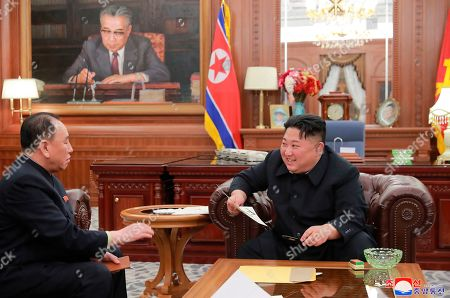 """Provided on Thursday, Jan. 24, 2019 by the North Korean government, North Korean leader Kim Jong Un, right, meets Kim Yong Chol, who traveled to Washington to discuss denuclearization talks, in Pyongyang, The North's Korean Central News Agency said Thursday that Kim Jong Un received a letter from U.S. President Donald Trump from the North Korean envoy who travelled to Washington and met Trump last week. North Korea. Independent journalists were not given access to cover the event depicted in this image distributed by the North Korean government. The content of this image is as provided and cannot be independently verified. Korean language watermark on image as provided by source reads: """"KCNA"""" which is the abbreviation for Korean Central News Agency"""