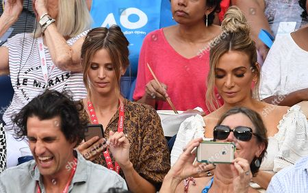 Australian model Brit Davis (L) and fashion blogger Nadia Bartel (R) are seen in the crowd during the men's singles semi final match between Stefanos Tsitsipas of Greece and Rafael Nadal of Spain at the Australian Open tennis tournament in Melbourne, 24 January 2019.