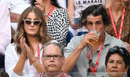 Australian radio personality Andy Lee (right) and girlfiend Rebecca Harding are seen in the crowd during the men's singles semi final match between Stefanos Tsitsipas of Greece and Rafael Nadal of Spain at the Australian Open tennis tournament in Melbourne, 24 January 2019.