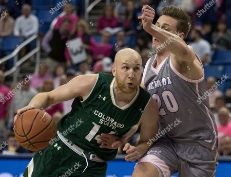 Stock Picture of Colorado State guard Robbie Berwick (14) drives past Nevada guard David Cunningham (20) in the second half of an NCAA college basketball game in Reno, Nev
