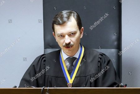Vlayslav Devyatko, the judge of the Obolon District Court announces a sentence of the former Ukrainian President Viktor Yanukovych in Kiev, Ukraine, 24 January 2019. In June 2017 Kyiv's Obolonsky District Court began the consideration of the case of the former President Viktor Yanukovich, who was accused of treason and other crimes committed before he fled to Russia in February 2014. Yanukovich was sentenced for 13 years in his absence.