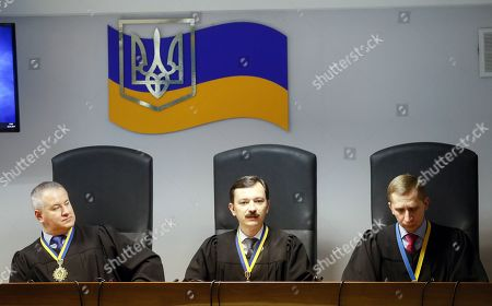 (L-R) Kostyantyn Vasalatiy, Vlayslav Devyatko and Maksym Tytov, the judges of Obolon District Court, announce a sentence of the former Ukrainian President Viktor Yanukovych in Kiev, Ukraine, 24 January 2019. In June 2017 Kyiv's Obolonsky District Court began the consideration of the case of the former President Viktor Yanukovich, who was accused of treason and other crimes committed before he fled to Russia in February 2014. Yanukovich was sentenced for 13 years in his absence.