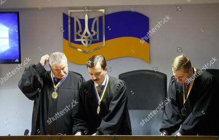 (L-R) Kostyantyn Vasalatiy, Vlayslav Devyatko and Maksym Tytov, the judges of Obolon District Court, attend announcing of sentence for the former Ukrainian President Viktor Yanukovych in Kiev, Ukraine, 24 January 2019. In June 2017 Kyiv's Obolonsky District Court began the consideration of the case of the former President Viktor Yanukovich who was accused of treason and other crimes committed before he fled to Russia in February 2014. Yanukovich was sentenced for 13 years in his absence.