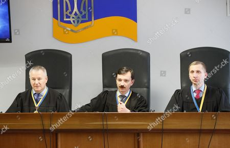 (L-R) Kostyantyn Vasalatiy, Vlayslav Devyatko and Maksym Tytov, the judges of Obolon District Court, announce a sentence for the former Ukrainian President Viktor Yanukovych in Kiev, Ukraine, 24 January 2019. In June 2017 Kyiv's Obolonsky District Court began the consideration of the case of the former President Viktor Yanukovich who was accused of treason and other crimes committed before he fled to Russia in February 2014. Yanukovich was sentenced for 13 years in his absence.
